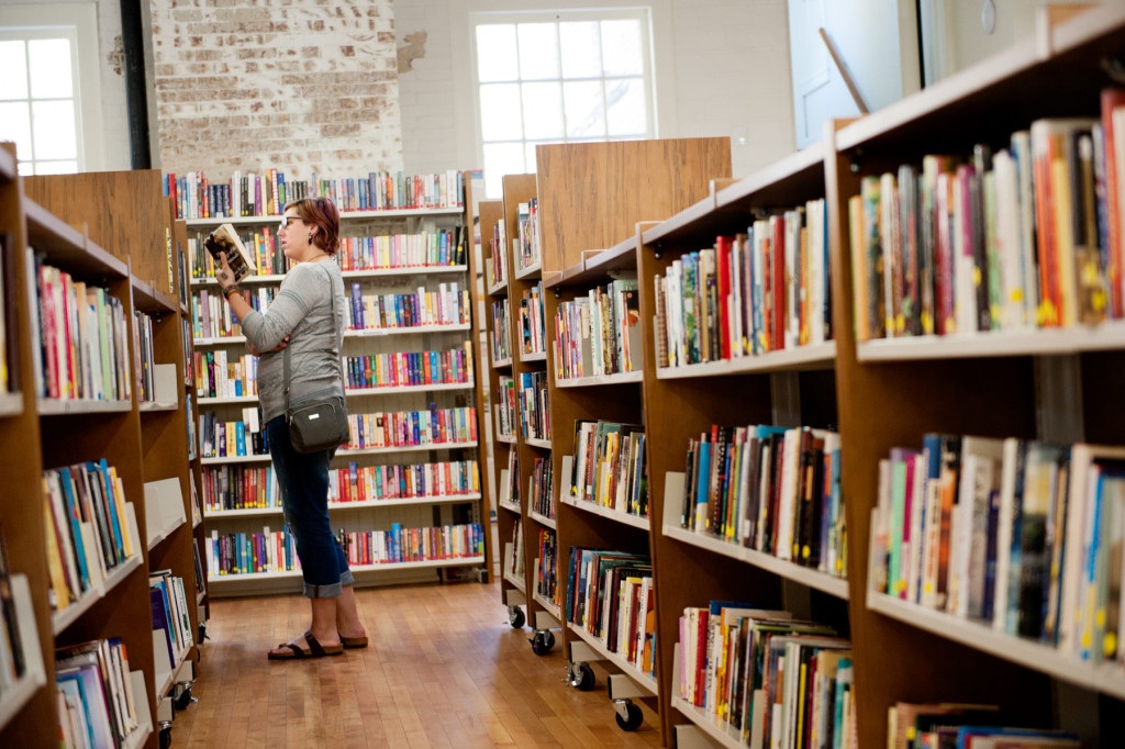 Kristi Newman of Fayetteville browses books on shelves during Opening Day at the Given Outpost on Wednesday, April 1, 2015 in Pinehurst, North Carolina.