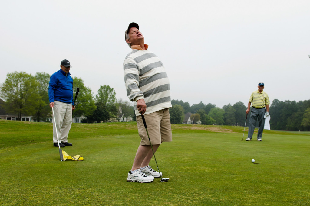 Woody Tanner (left) and Lyle Cooper (right) watch as Bob Lamoree (center) reacts after missing a putt at the one green while playing a round with friends from Midloathian, Virginia at Longleaf Golf and Country Club on Friday, April 17, 2015 in Southern Pines, North Carolina. Lamoree said the group is in the Sandhills for a golf outing, and Friday was their last day.