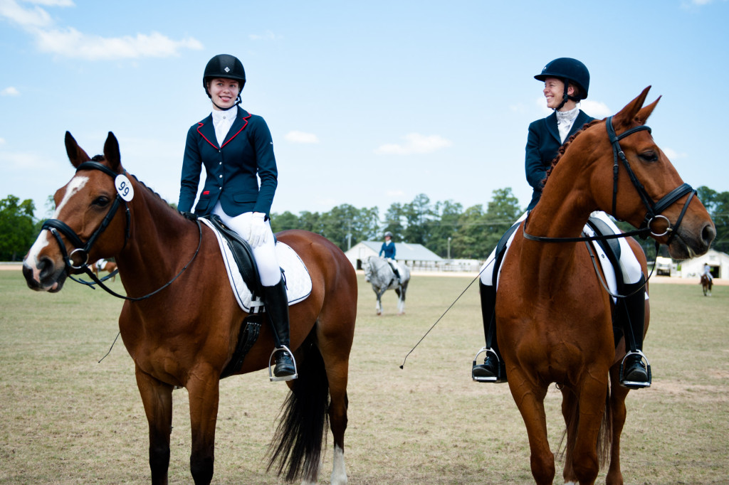 Lisa Wall (right), of Apex, sits on her horse Baaron Miller as she smiles and laughs with her daughter Olivia Wall (left), who's sitting on her horse Mandolin R, as they wait for their scheduled riding times during the Dressage in the Sandhills Horse Show at the Pinehurst Harness Track on Friday, May 8, 2015 in Pinehurst, North Carolina.