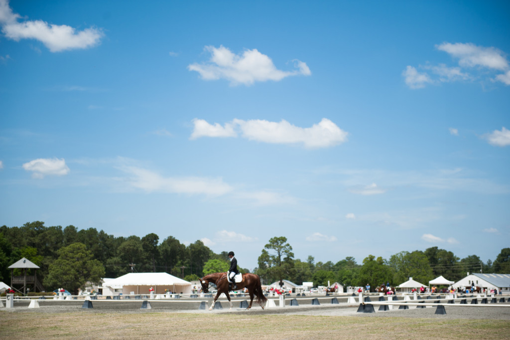 John Schaaf rides away from arena C on Ferrante Cf during the Dressage in the Sandhills Horse Show at the Pinehurst Harness Track on Friday, May 8, 2015 in Pinehurst, North Carolina.