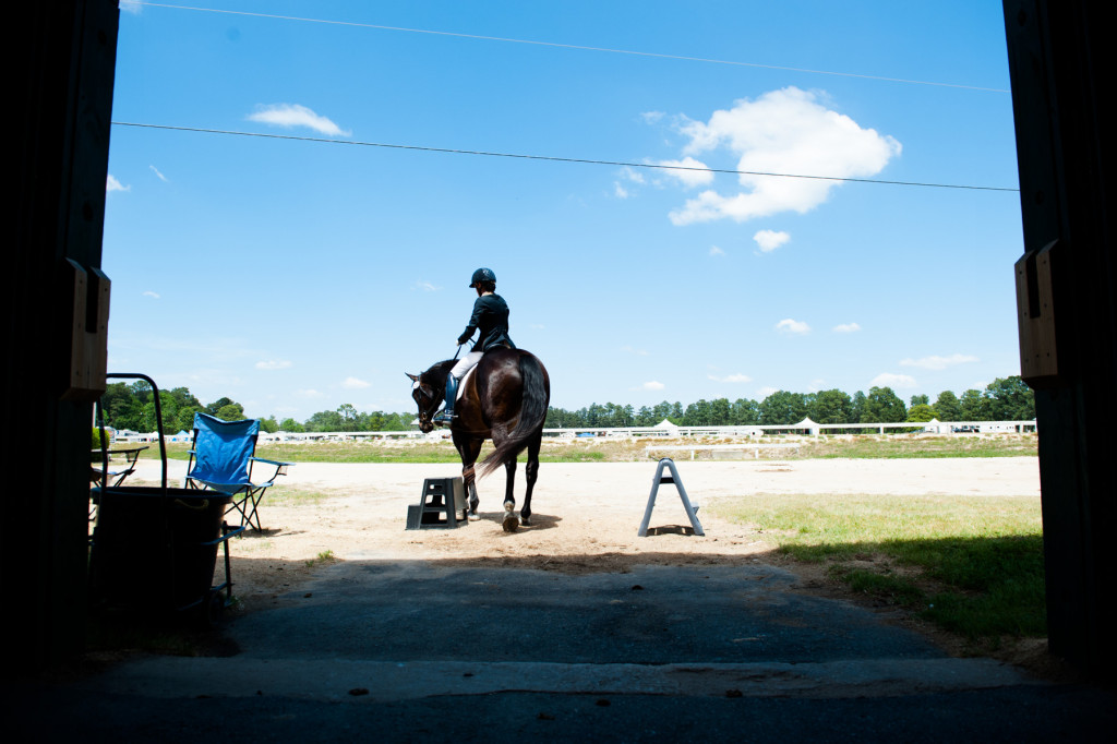 Diane Ritz and Brio leave for the competition ring during the Dressage in the Sandhills Horse Show at the Pinehurst Harness Track on Friday, May 8, 2015 in Pinehurst, North Carolina.