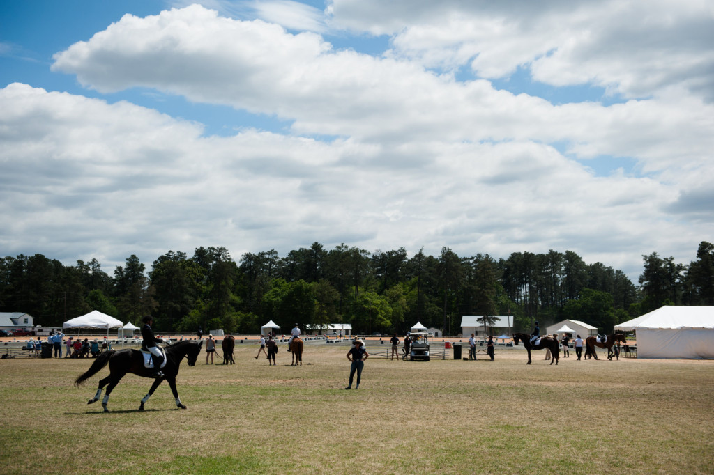 Horses and riders are seen from the infield of the harness track during the Dressage in the Sandhills Horse Show at the Pinehurst Harness Track on Friday, May 8, 2015 in Pinehurst, North Carolina.