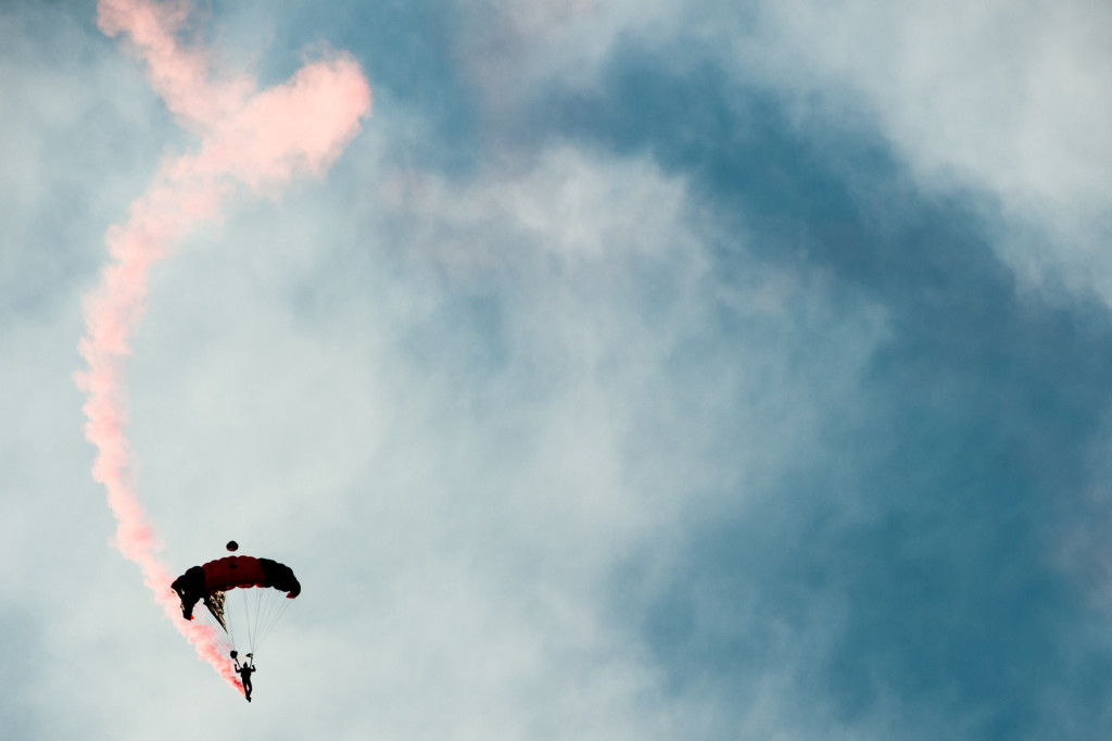 The U.S. Army Special Operations Command Parachute Demonstration Team, which is known as the Black Daggers, performs a show for those gathered at the driving range at the Pinehurst Country Club on Wednesday, July 22, 2014 in Pinehurst, North Carolina.
