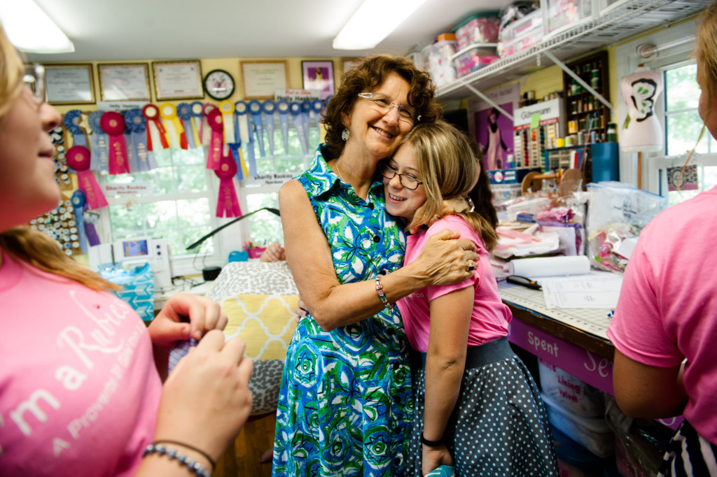 Yvonne Haskins hugs 12-year-old Lily Davis during Rubies Camp, which is hosted by Haskins who teaches young girls how to sew items from decorative banners, to ottoman poofs, to pieces of clothing, at her home on Thursday, July 9, 2015 in Aberdeen, North Carolina. Haskins has known Davis since she was 6-years-old.