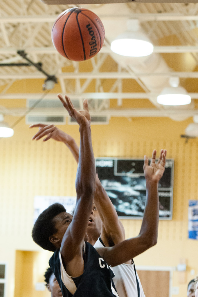 Tyrese Kelly of the Cyclones, which is a Moore County youth basketball team, puts up a shot during practice at Crain's Creek Middle School on Monday, July 13, 2015 in Carthage, North Carolina.The team recently qualified for a National Amateur Athletic Union tournament which will take place at the end of July in Louisville, Kentucky.