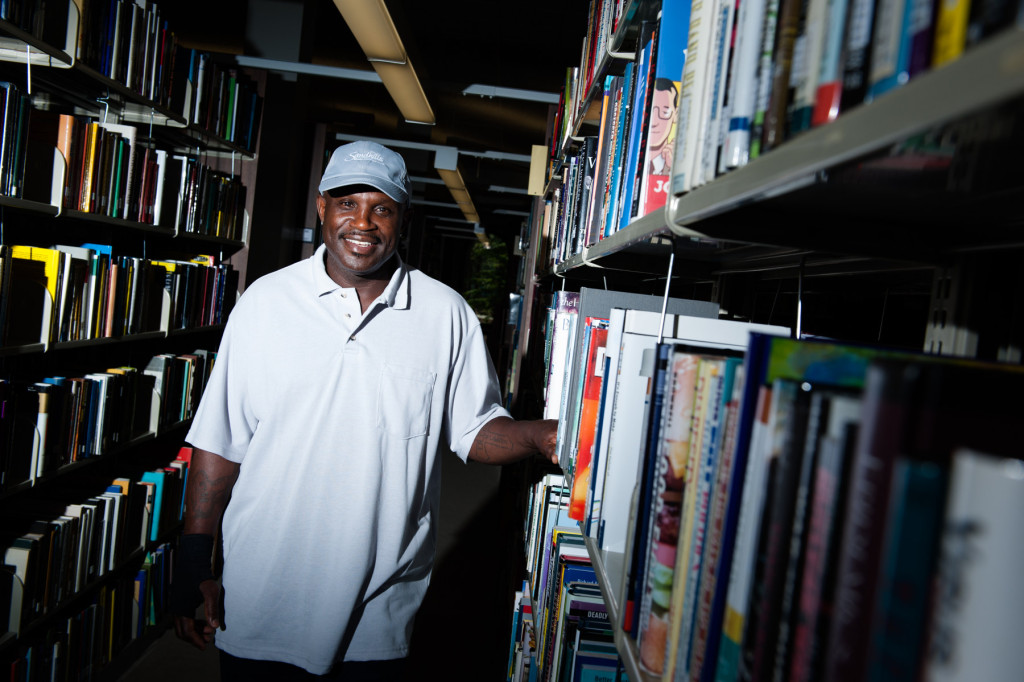 Ricky Stephens stands for a portrait in the library on campus at the Sandhills Community College on Wednesday, July 22, 2015 in Southern Pines, North Carolina. Stephens is a janitor at the college, but plays pickle ball in his free time and regularly competes.