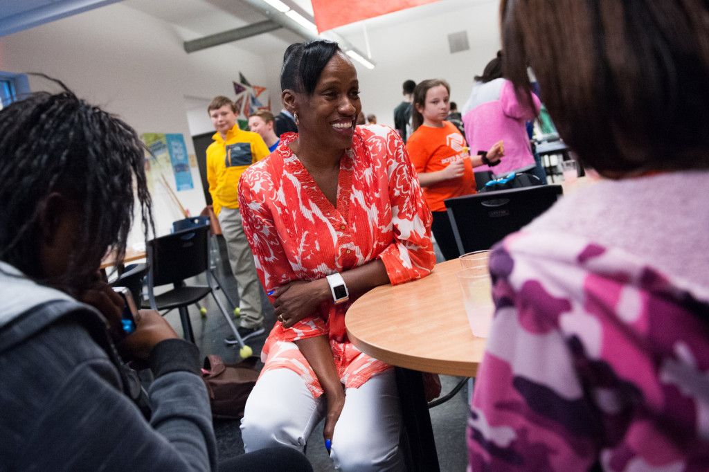 Olympian Jackie Joyner-Kersee shakes speaks with kids during a meet and greet in the Teen Center at the Boys and Girls Club on Thursday, September 24, 2015 in Southern Pines, North Carolina.