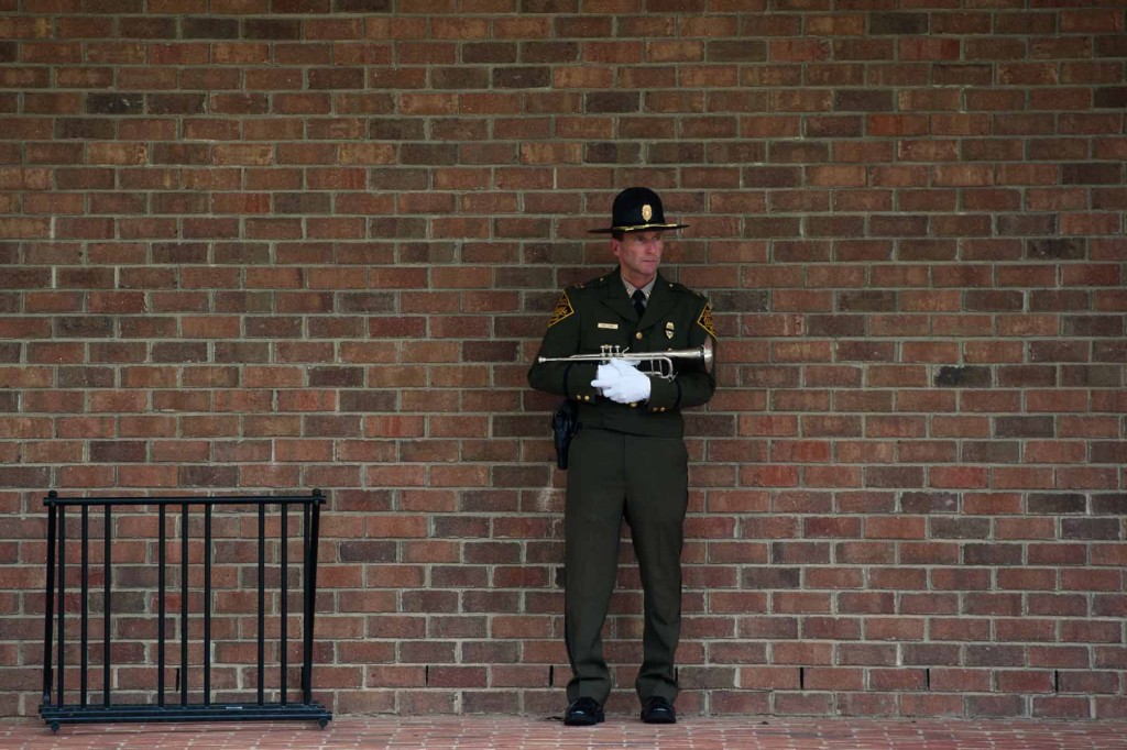 Captain Matt Long, who's with the NC Wildlife Resources Commission, stands near Van Dusen Hall as he waits to perform Taps  during the Moore County Public Safety Memorial Dedication on campus at Sandhills Community College on Friday,  September 11, 2015 in Pinehurst.