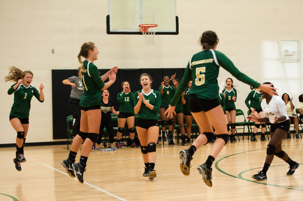 Members of the Pinecrest team celebrate after winning a match during a volleyball match between Pinecrest High's School Junior Varsity team and Jack Britt High School's Junior Varsity team at Pinecrest High School on Wednesday, September 30, 2015 in Southern Pines, North Carolina.