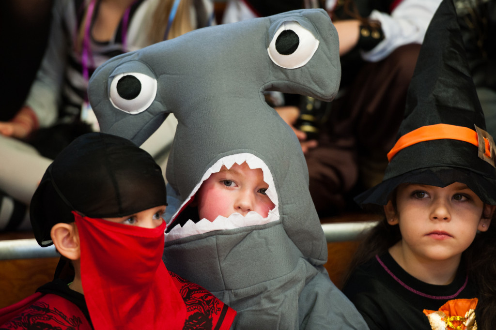Andy Murphy sits in the stands as a hammerhead shark as he waits for the parade to begin in the gymnasium of High Falls Elementary School on Friday, October 30, 2015 in Robbins, North Carolina.