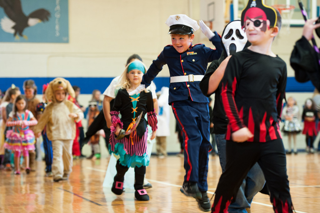 Eli Meyers, dressed as a military member, jumps and laughs as he walks during the Halloween Costume parade in the gymnasium of High Falls Elementary School on Friday, October 30, 2015 in Robbins, North Carolina.