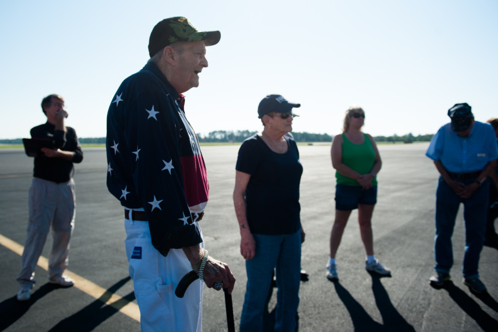 Adrian de Pasquale, DeeDee Miller and other people from the Southern Pines Gracious Living Retirement Community  listen to Founder, President and Pilot of Ageless Aviation Darryl Fisher  before he takes guests on rides in his Boeing Stearman biplane at the Moore County Airport on Tuesday, September 1, 2015 in Whispering Pines.