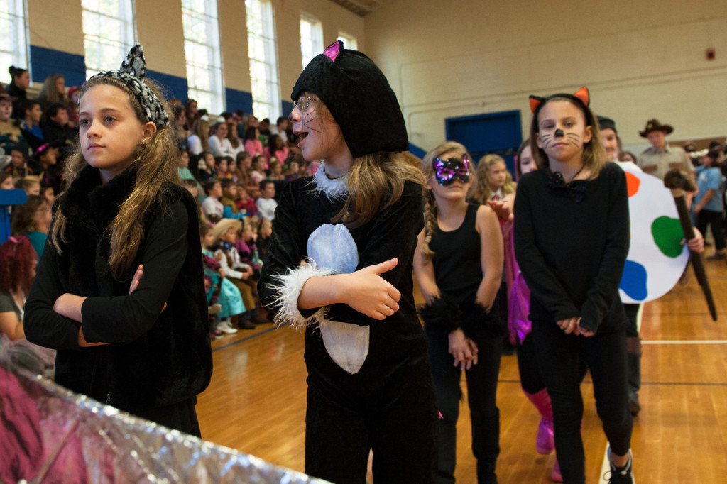Students walk as various characters during the Halloween Costume parade in the gymnasium of High Falls Elementary School on Friday, October 30, 2015 in Robbins, North Carolina.