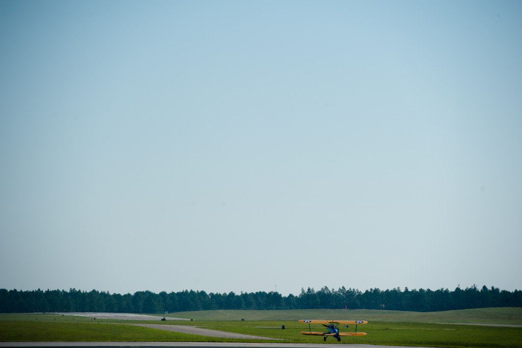 Pilot Darryl Fisher taxies with DeeDee Miller in the co-pilot seat as he takes her for her Ageless Aviation ride at the Moore County Airport on Tuesday, September 1, 2015 in Whispering Pines.