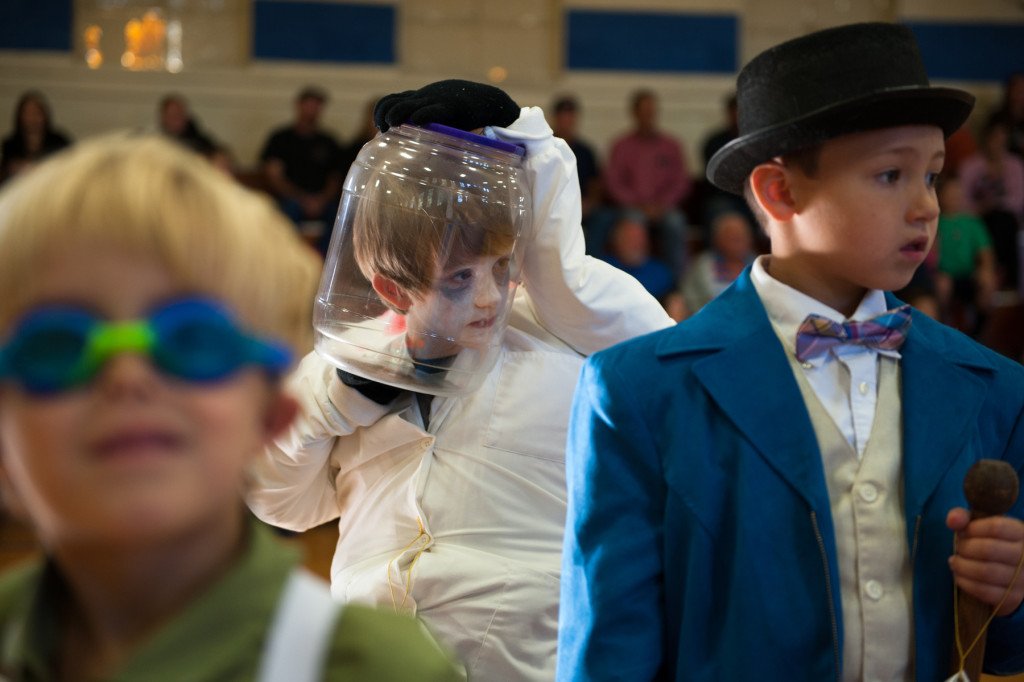 Jeremiah Britt (center) won first place for his Headless Scientist costume during the Halloween Costume parade in the gymnasium of High Falls Elementary School on Friday, October 30, 2015 in Robbins, North Carolina.