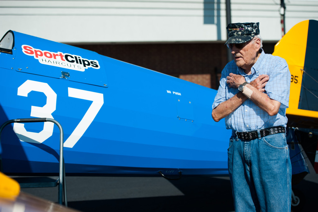 Larry Deister makes a joke and crosses his chest before taking his turn in Founder, President and Pilot of Ageless Aviation Darryl Fisher's plane at the Moore County Airport on Tuesday, September 1, 2015 in Whispering Pines.