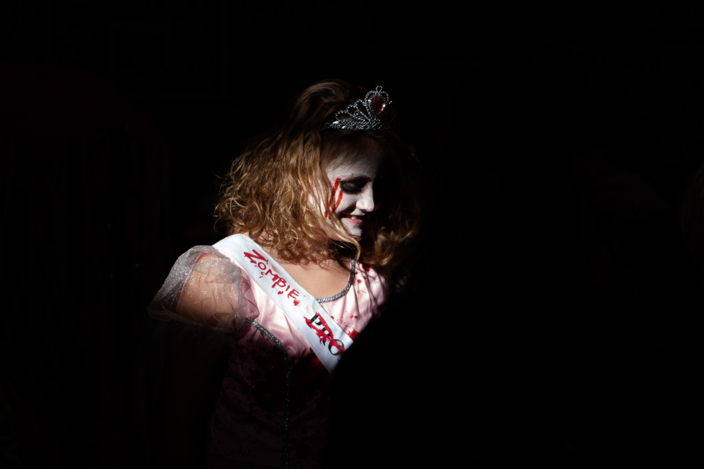 Zoey Upchurch walks through a band of light streaming through the gymnasium windows while dressed as a Zombie Prom Queen during the Halloween Costume parade in the gymnasium of High Falls Elementary School on Friday, October 30, 2015 in Robbins, North Carolina.