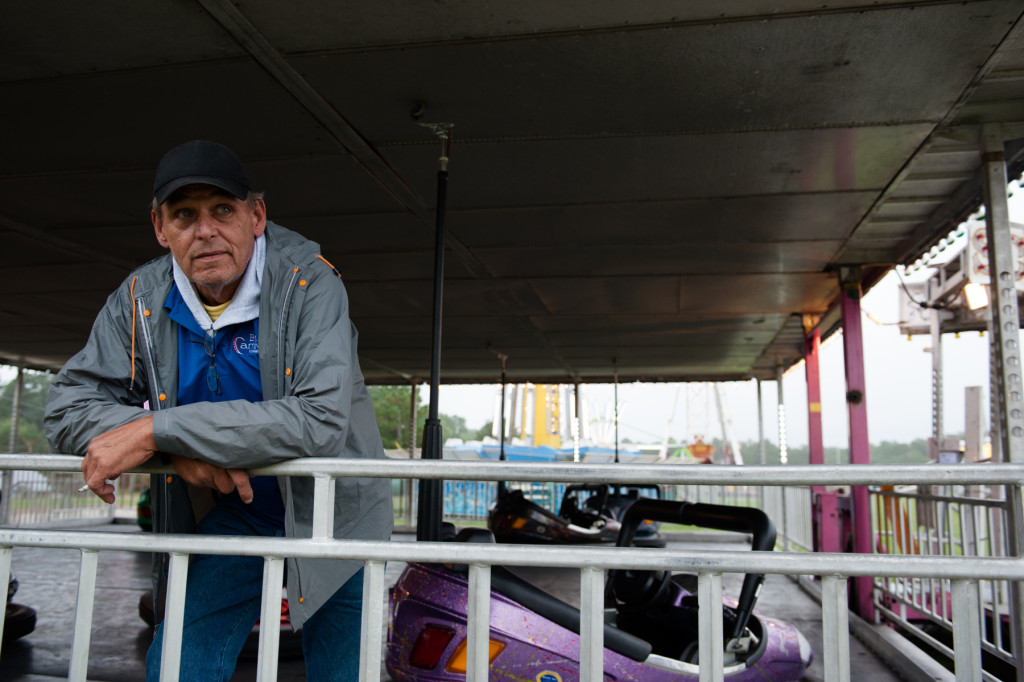 Bumper Car Operator George Wills waits for the gates to open at the Moore County Fair on Thursday, October 1, 2015 in Carthage, North Carolina.