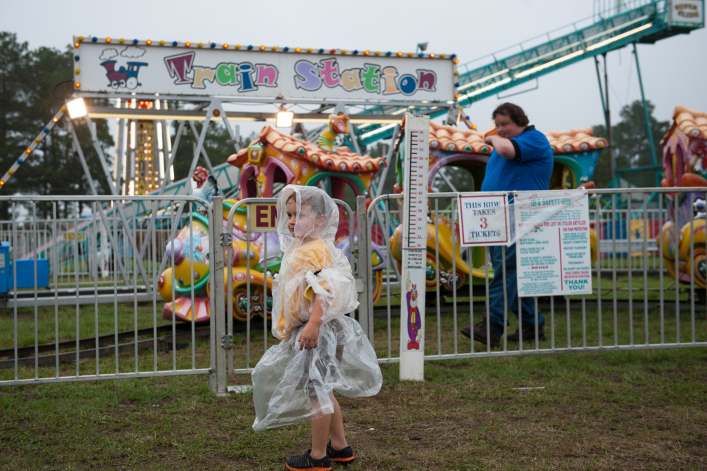 Three-year-old Shawn Ryder waits for his group as he picks the next ride at the Moore County Fair on Thursday, October 1, 2015 in Carthage, North Carolina.