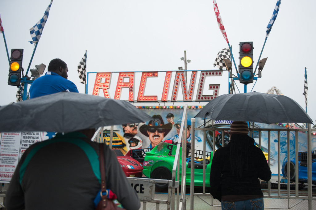 As the rain intensifies, umbrellas are seen across the grounds at the Moore County Fair on Thursday, October 1, 2015 in Carthage, North Carolina.