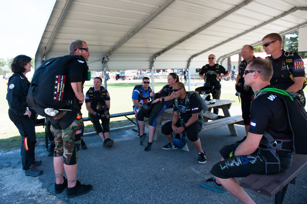 Beth Patterson Casilio and Robbie Rushton stand with other jumpers who are waiting for their plane at the Raeford Drop Zone on Thursday, October 8, 2015 in Raeford, North Carolina.