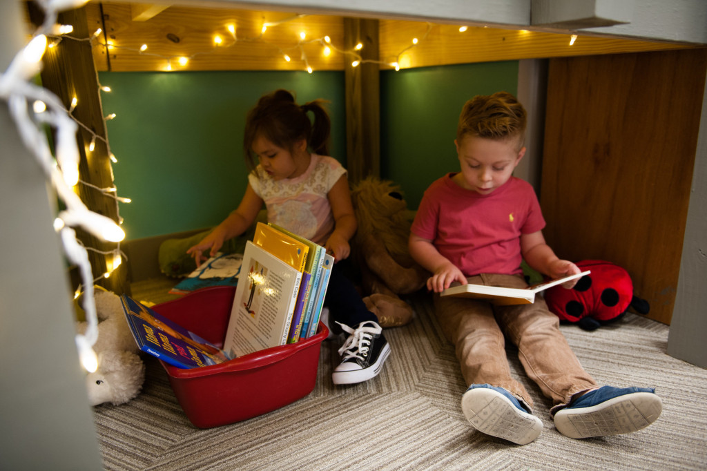 Kialee Lopez and Liam Lambert flip through books in a little reading nook at HOPE Academy, a recently opened pre-school, on Wednesday, September 16, 2015 in Robbins, North Carolina.