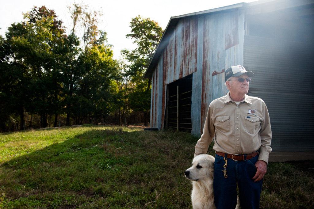 Jackie Bean pets Joe, the farm's dog, at D and J Goat Farms on Friday, October 16, 2015 near Robbins, North Carolina. Jackie Bean and his son Derek Bean have been raising livestock for years, specializing in goats for almost a decade. The farms produce commercial stock, breeding stock and show stock Boer goats.
