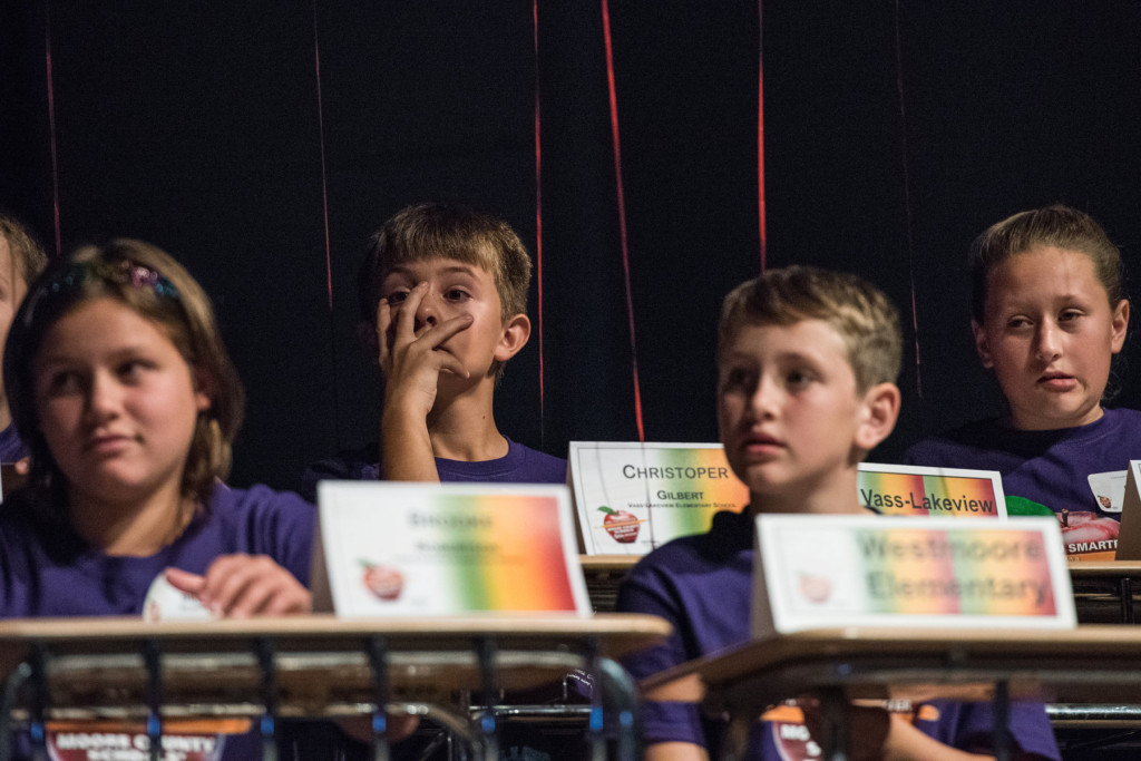 "Christopher Gilbert (center, background), of Vass-Lakeview Elementary, reacts with his teammates after missing a question during the ""Are you Smarter than a Fifth Grader"" Contest at Pinecrest High School on Thursday, November 12, 2015 in Southern Pines, North Carolina."