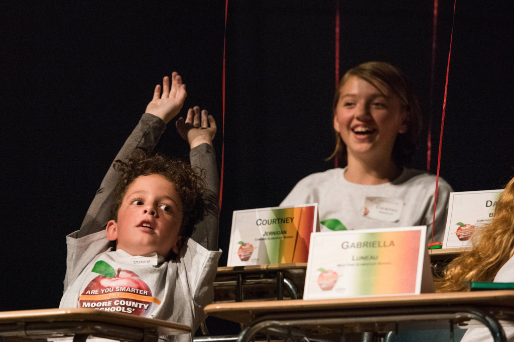 "Marco Wellner celebrates with his team during the ""Are you Smarter than a Fifth Grader"" Contest at Pinecrest High School on Thursday, November 12, 2015 in Southern Pines, North Carolina."