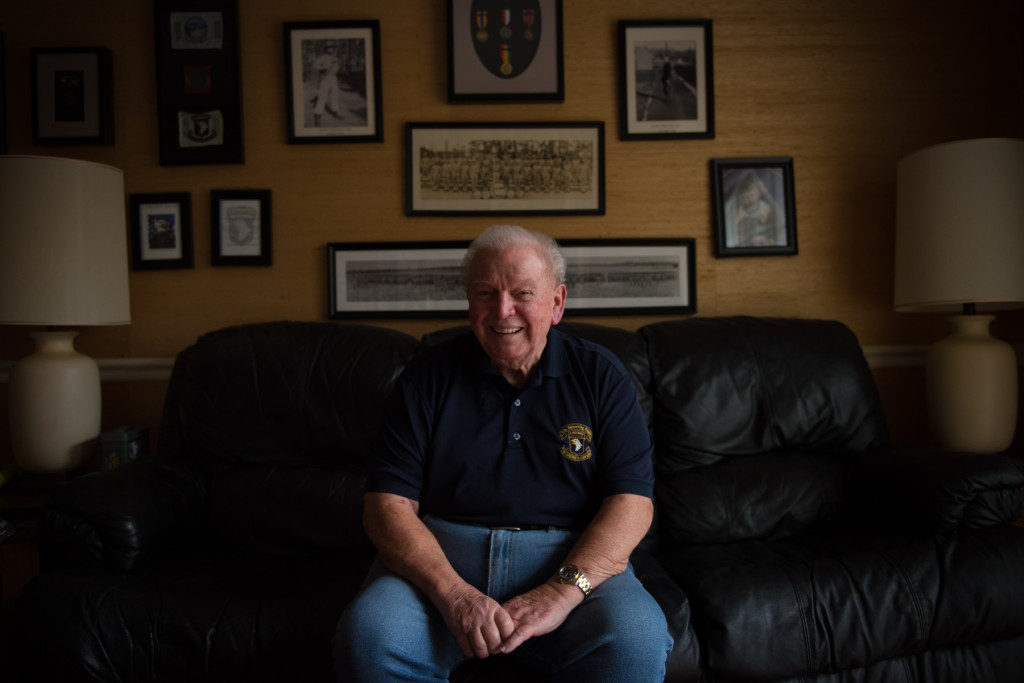"Eugene C. Deibler, 91-years-old, of Pinehurst, sits for a portrait in his ""war room"" den on Wednesday, November 18, 2015 in Pinehurst, North Carolina. Deibler received the Legion of Honor Medal for his efforts in the liberation of France from German occupation in World War II as a paratrooper with the 101st Airborne. The National Order of the Legion of Honor is the highest award given by France, which also grants its recipient the honorable distinction of knighthood."