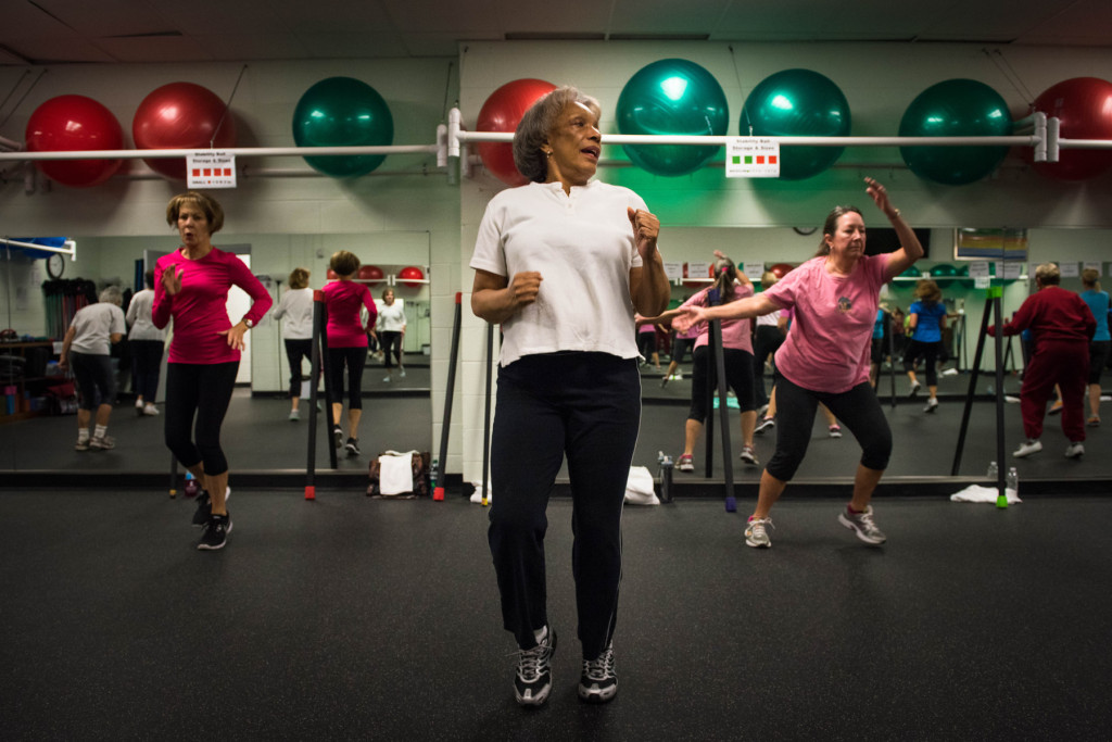 Queen Steele (center) participates during a Tabata class at the Senior Enrichment Center on Monday, November 23, 2015 near West End, North Carolina.