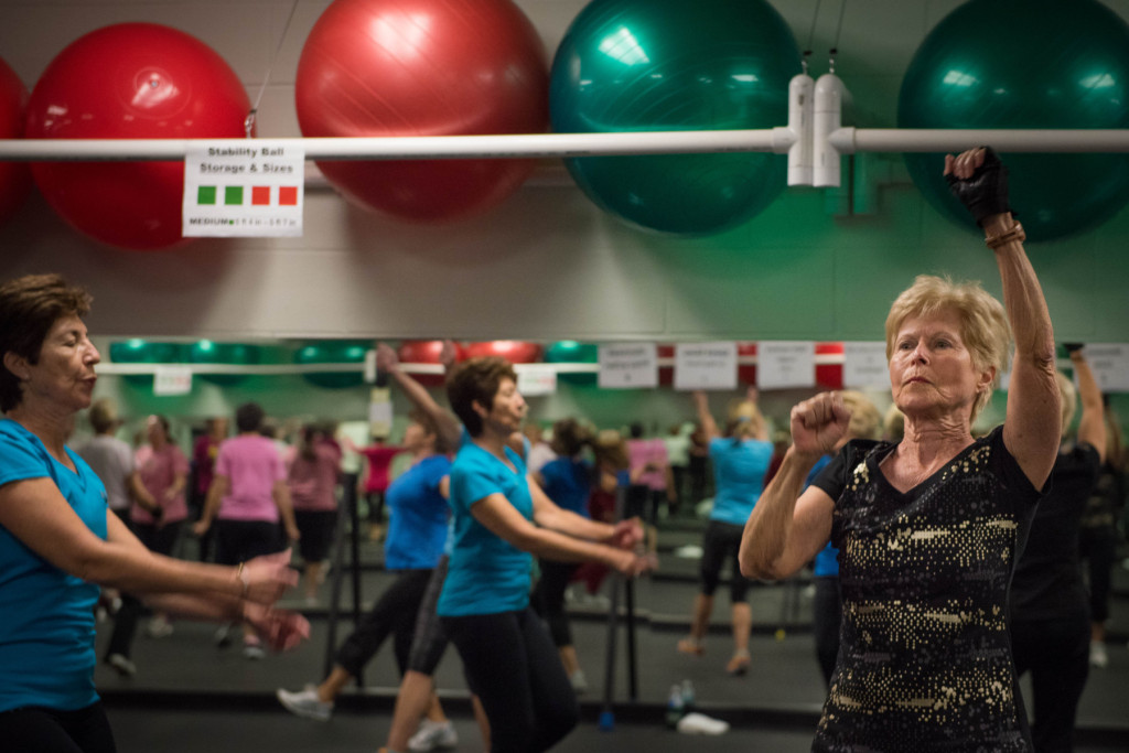 Nan Wood (right), along with other classmates, go through the various high-intensity exercises during a Tabata class at the Senior Enrichment Center on Monday, November 23, 2015 near West End, North Carolina.