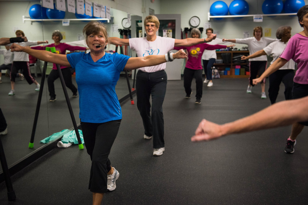 Instructor Esther Zollman (left) has the class follow her during a Tabata class at the Senior Enrichment Center on Monday, November 23, 2015 near West End, North Carolina.