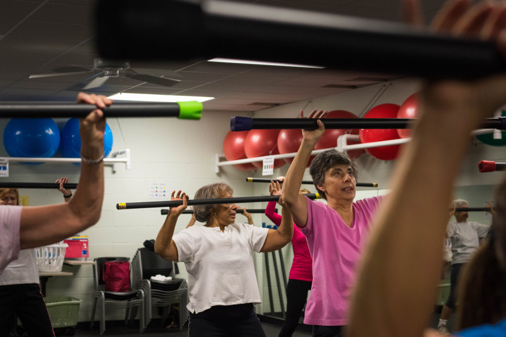 Queen Steele (center) participates, along with other classmates, during a Tabata class at the Senior Enrichment Center on Monday, November 23, 2015 near West End, North Carolina.