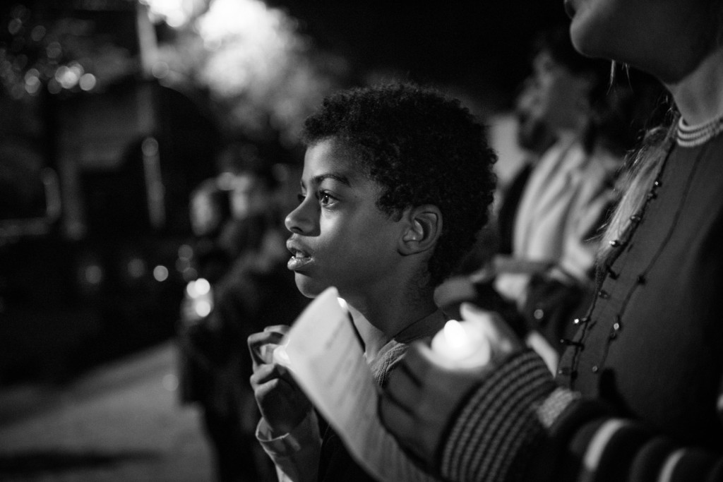 Ten-year-old Godwin Linder watches the stage during a candlelight vigil for the homeless, in support of National Homeless Persons' Memorial Day, on Monday, December 21, 2015 hosted by St. Joseph of the Pines, at Downtown Park in Southern Pines, North Carolina.