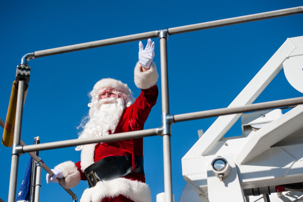 Santa Claus waves from the top of a fire truck during the Southern Pines Christmas Parade that took place down the south side of Broad Street on Saturday, December 5, 2015 in Southern Pines, North Carolina.