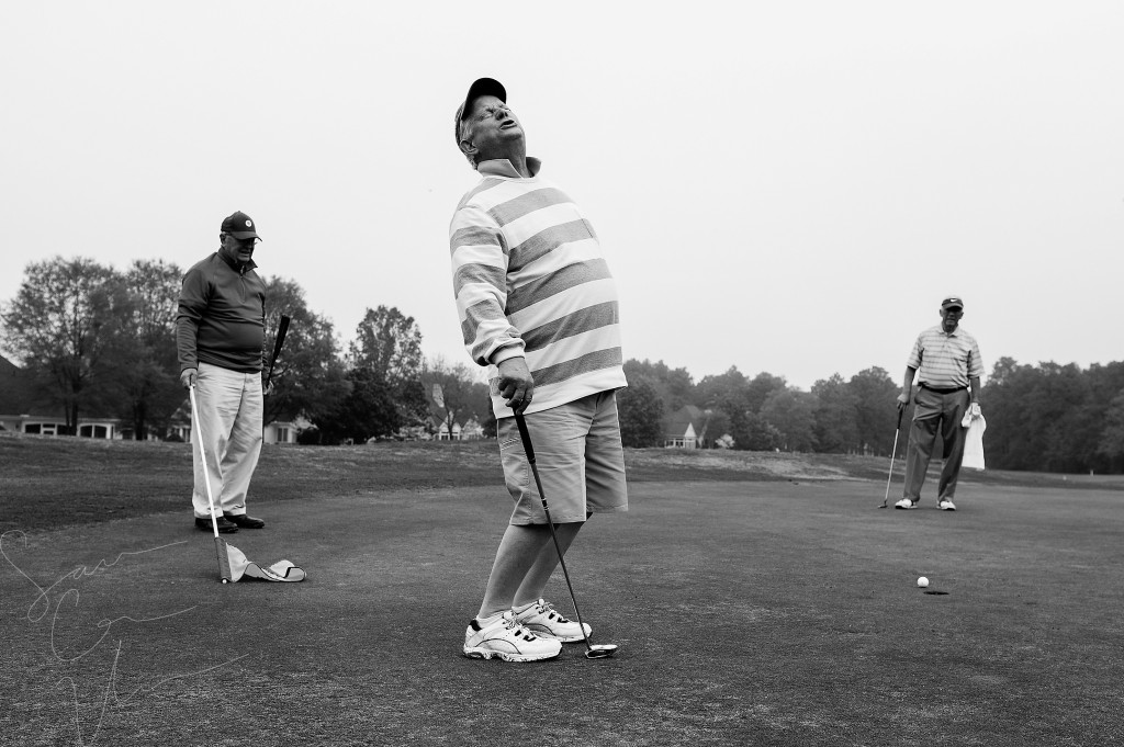 Woody Tanner (left) and Lyle Cooper (right) watch as Bob Lamoree (center) reacts after missing a putt at the one green while playing a round with friends from Midloathian, Virginia at Longleaf Golf and Country Club on Friday, April 17, 2015 in Southern Pines, North Carolina.