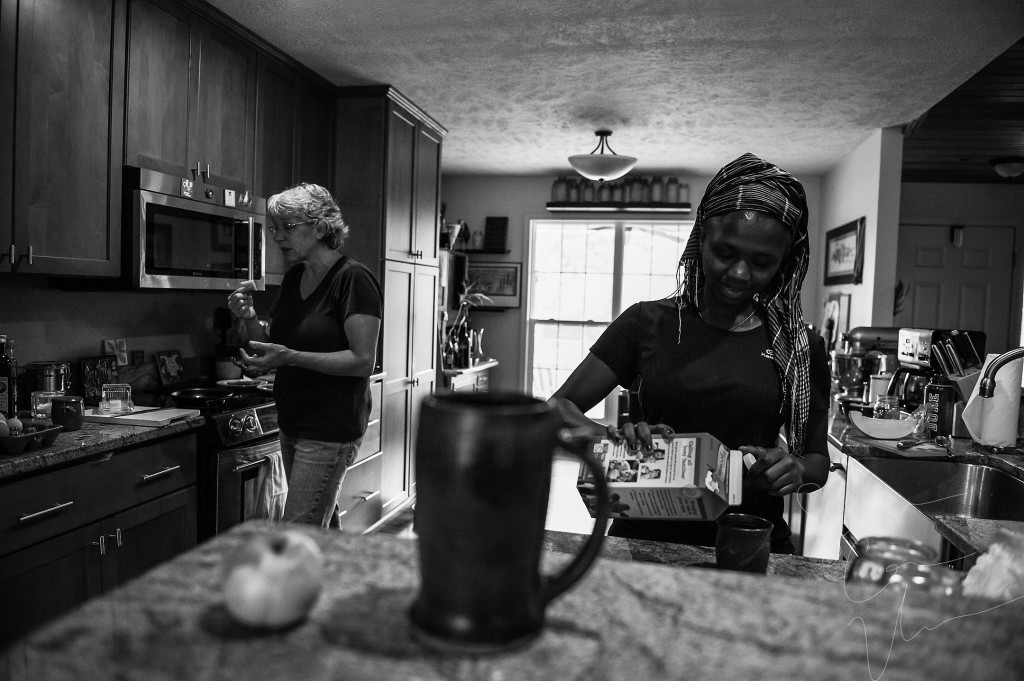 Sue Stovall makes breakfast after an early morning of milking goats, as Tema Toure, the volunteer, pours creamer in her coffee, in the main house at Paradox Farm on Tuesday, July 14, 2015 in West End, North Carolina.